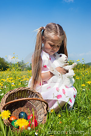Child petting Easter bunny