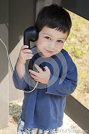 Child in phone box