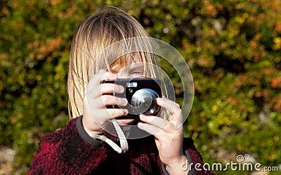 Child photographer photographing taking photo