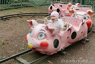 Child on piggy train in entertainment park