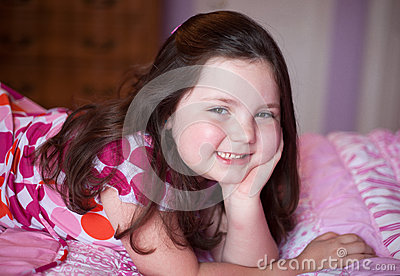 Child with pink rosy cheeks