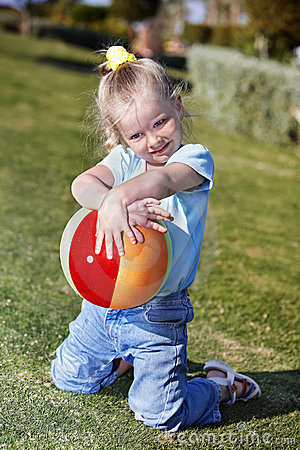Child Play With  Ball In  Park Stock Image - Image: 18437621