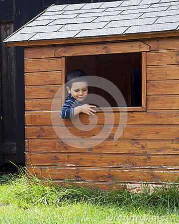 Child in play house