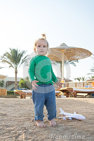 Free Child Play On Sand Beach. Small Boy With Plane Toy Outdoor. Kid Have Fun On Summer Vacation. Imagination, Freedom And Dream Concep Royalty Free Stock Photo - 115035835