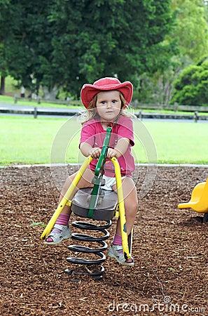 Child on playground seesaw