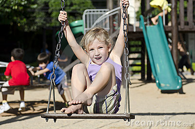 Child on the playground swinging