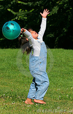A Child Playing With a Ball
