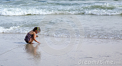 Child playing at beach.
