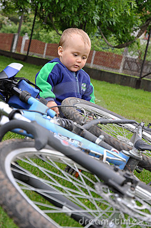 Child playing with bicycle