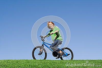 Child playing on bike