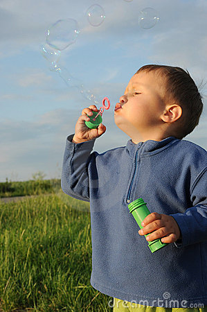 Child playing with bubble gum