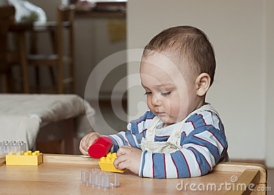 Child playing with building blocks
