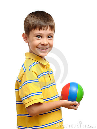 Child playing with colorful toy rubber ball