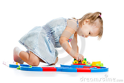 Child playing  with colourful ton white background