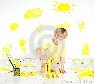 Child playing with construction blocks. Creativity