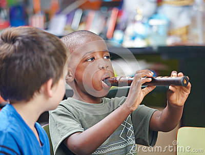 Child playing flute in music school