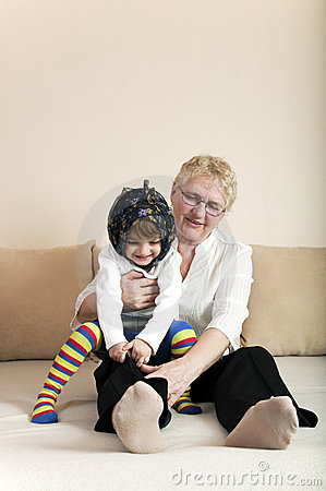 Child playing with grandmother
