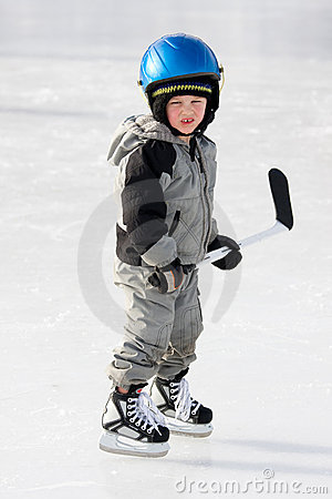 Child playing hockey