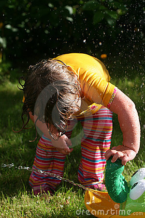 Child playing on a hot summer day