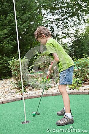 Child playing miniature golf