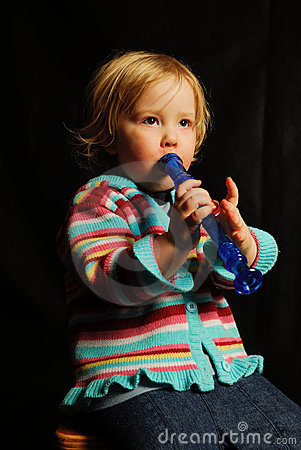 Child playing music on flute