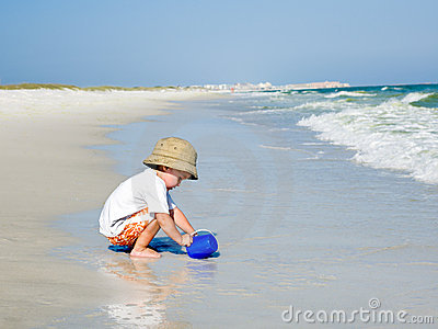 Child Playing by the Ocean
