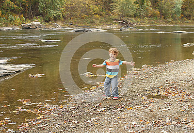 Child playing outside, fall season