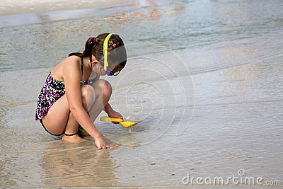 Child playing in the sand.