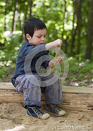 Child playing in sandbox