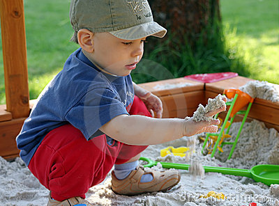 Child is playing in sandbox