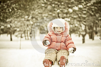 Child playing at snowballs