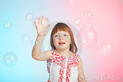 Child playing with soap bubbles