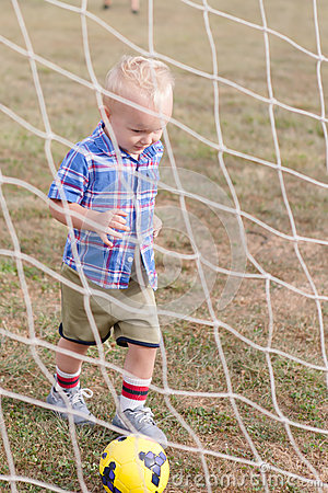 Free Child Playing Soccer Stock Photography - 64378622