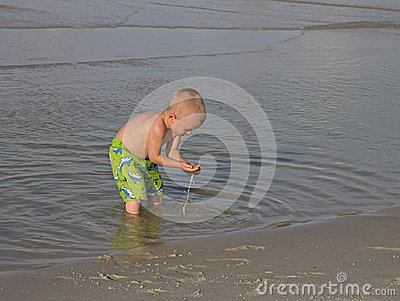 Child playing in the surf.