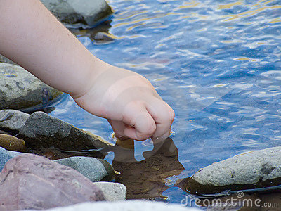 Child playing with water