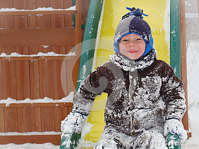 Child playing in winter snow