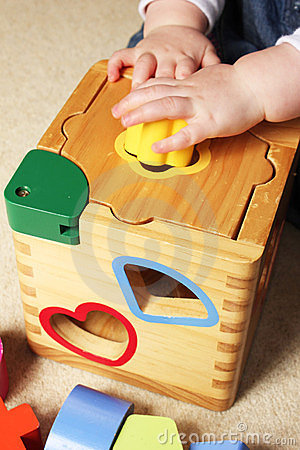 Free Child Playing With Shape Sorter Stock Photography - 15257052