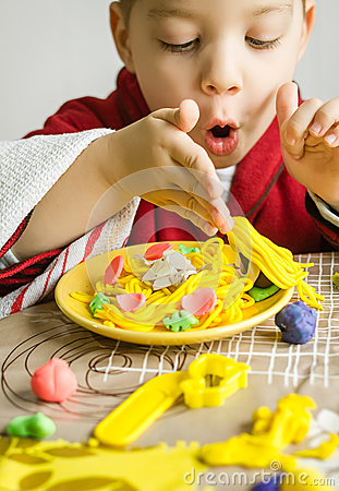 Free Child Playing With Spaghetti Dish Made With Plasticine Royalty Free Stock Image - 31008926