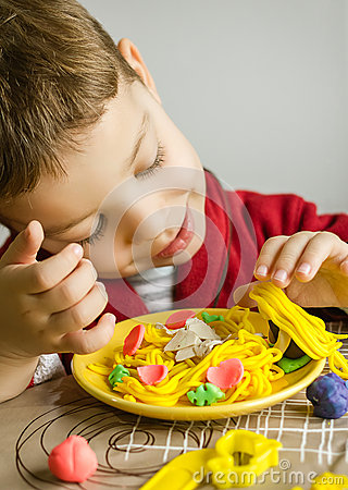 Free Child Playing With Spaghetti Dish Made With Plasticine Royalty Free Stock Image - 31014476