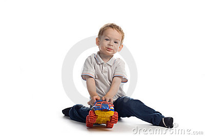 Child plays with car