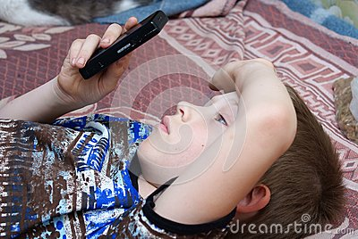 The child plays games on the mobile phone