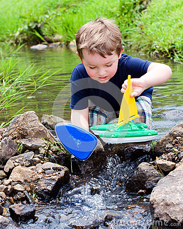 Free Child Plays With Boat In Creek Royalty Free Stock Photo - 25580895