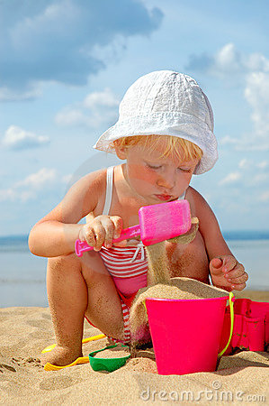 Free Child Plays With Toy In Sand Stock Images - 19718174