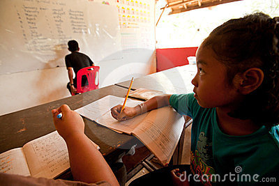 Child from poor areas in lession at school Editorial Stock Image