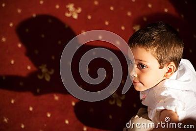 Child portrait with shadow