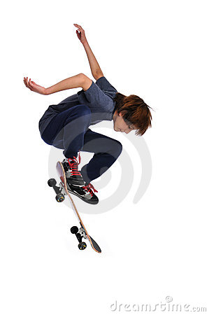 Child practicing a trick on skateboard