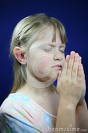 Child praying.