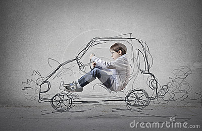 Child pretending to drive a drawn car
