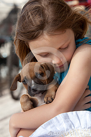 Child with puppy dog