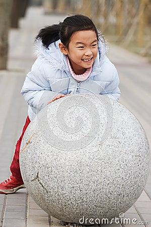 Child push stone ball